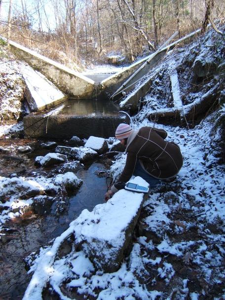 Carla Whisner sampling a pasture stream in Coshocton, Ohio.