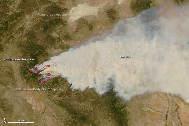 satellite photograph showing the Whitewatr-Baldy fire complex and the large plume of smoke blowing off to the east.
