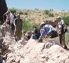 Students examine a fault scarp