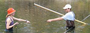 Two students gathering streamflow data in the Cannon River