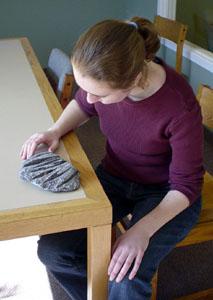 Kendra examines orthoceras fossils in a matrix