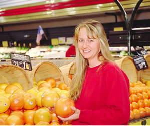 Purchasing fresh produce at the grocery store