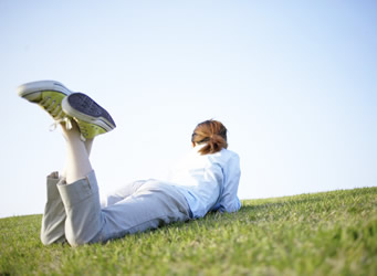 A student lying in the grass