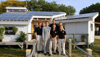 Students from the University of Colorado pose in front of their solar house