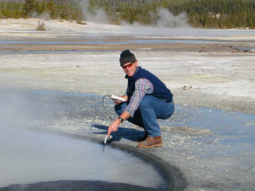 George Rice checking a thermal pool for temp and pH
