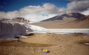 U.S. Antarctic Program field camp at Lake Hoare in the McMurdo Dry Valleys, with the Canada Glacier in the background.