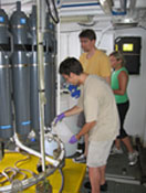 Students from Marine Microbial Ecology Course collecting samples from the CTD.