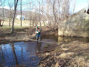 A man gauges a stream.