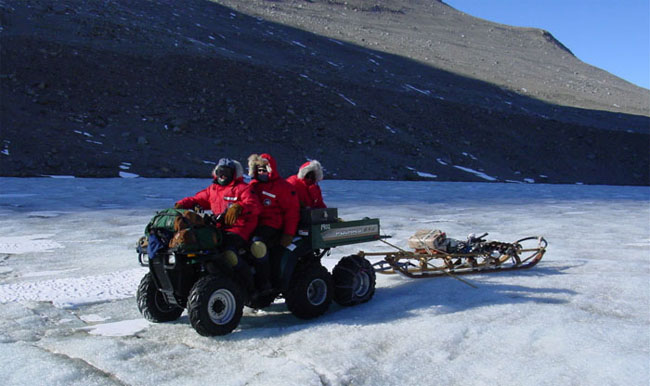 ATV hauling gear on Lake Bonney.
