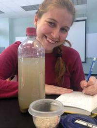 Student studying sediments