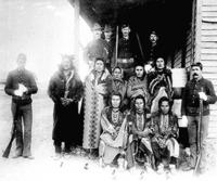 Eight Crow prisoners under guard at Crow agency, Montana.