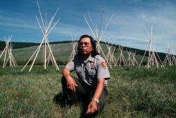 Otis Halfmoon, a U.S. Park Ranger, kneeling at BigHole Ntn