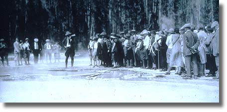 Old photograph of Yellowstone ranger talking.