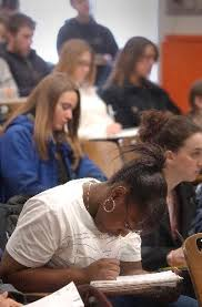 Students taking notes during a lecture