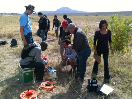 Students in a Geophysical Methods field course engaged conducting a geophysical study.