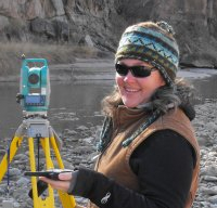 Amy Ellwein surveying the Chama River thalweg.
