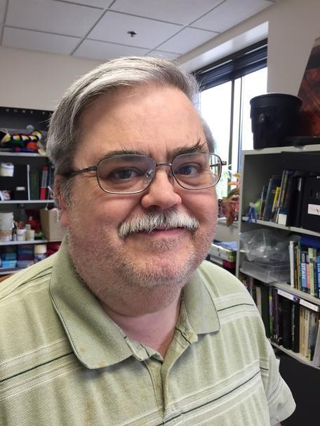 Dr. Dan E. Olson