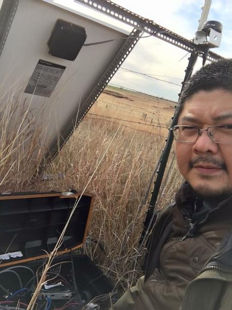 Jefferson Chang, posing next a seismic station
