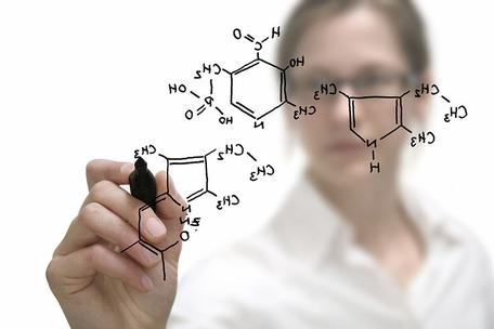 Chemical compound being drawn by female chemist.