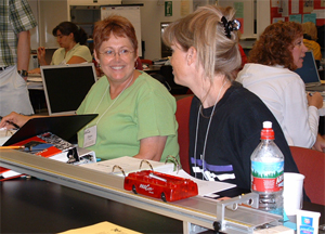 Teachers working on a physics activity during the NCOSP Summer Academy.