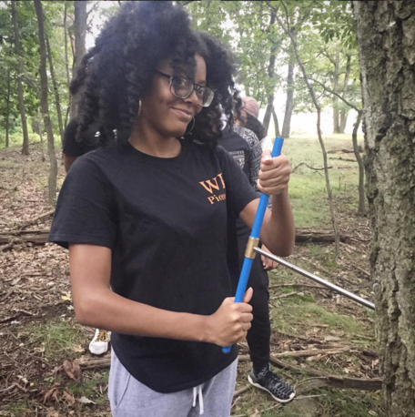 WPU ENV student Latasia Watkins cores a tree in her Fundamentals of Earth Science course. By Mike DaSilva